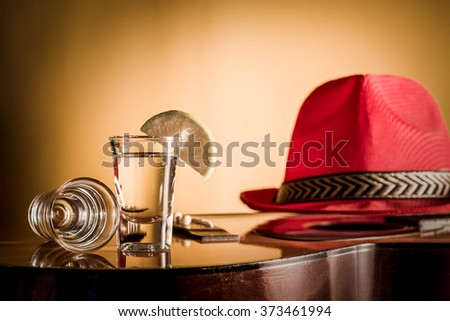 glass of vodka and Classical guitar with red hat. - stock photo