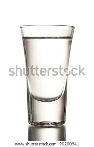 Glass of vodka isolated on white - stock photo