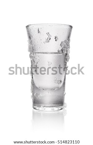 Glass of vodka with ice crystals isolated on white background with clipping path