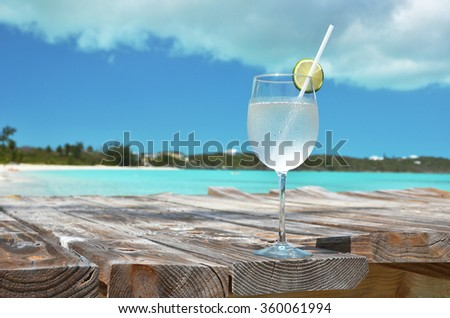 Glass of water against ocean - stock photo