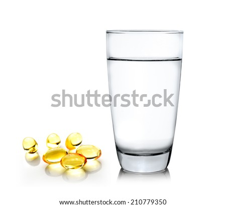 Glass of water and fish oil isolated on white background - stock photo