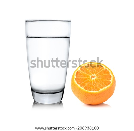 Glass of water and Half orange fruit on white background, fresh and juicy - stock photo