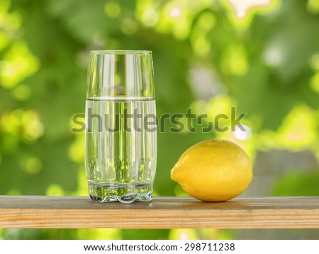 Glass of water and lemon - stock photo