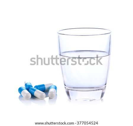 Glass of water and pills isolated on white background - stock photo