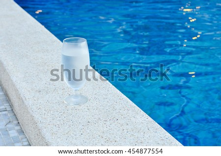 Glass of water, cool water in glass on blue background