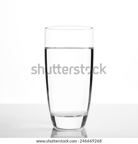 Glass of water on light background - stock photo