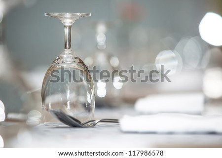 Glass of water on luxury table setting for dining, selective focus with bokeh background - stock photo