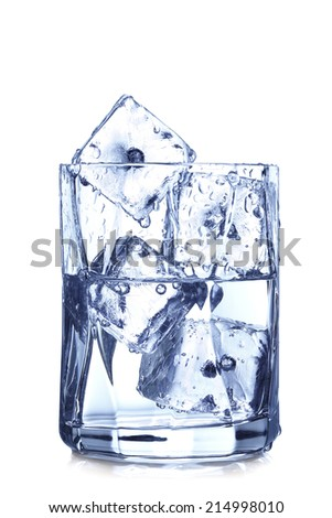 glass of water with ice cubes on white - stock photo