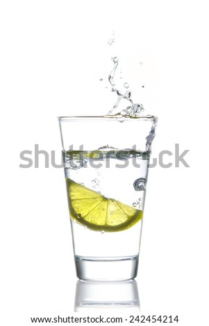 Glass of water with lemon - stock photo
