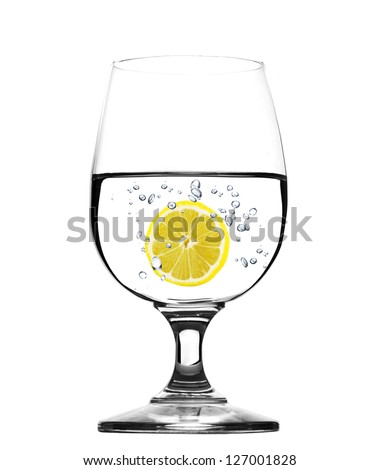 Glass of water with lemon -concept - stock photo