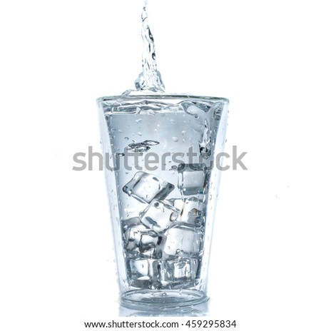 Glass of water with water splash.