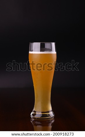 Glass of wheat bear over a dark background