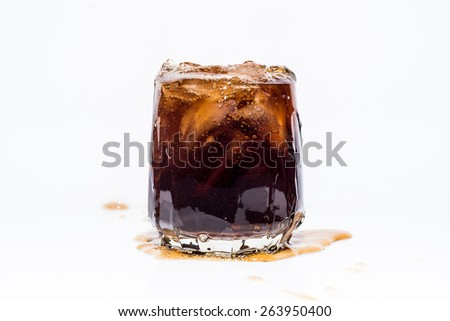 Glass of whiskey and cola with ice - stock photo