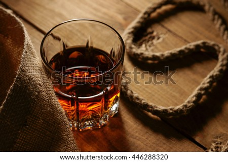 [stock-photo-glass-of-whiskey-and-rope-446288320]