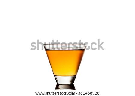 Glass of whiskey isolated on white background - stock photo