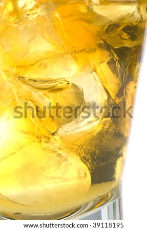 Glass of whiskey on the rocks macro stock photo