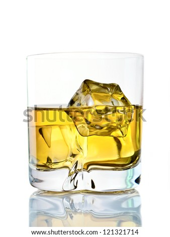 Glass of whiskey on the rocks on white background - stock photo