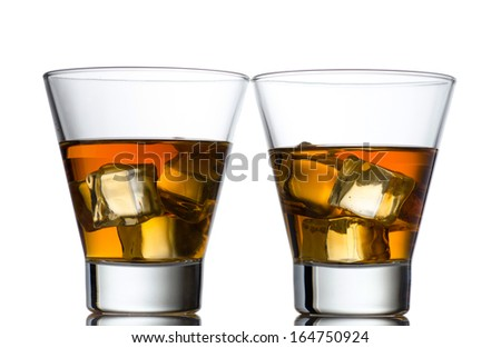 Glass of whiskey solated on white background - stock photo