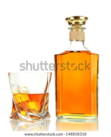 Glass of whiskey with bottle, isolated on white - stock photo