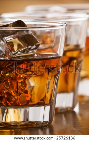 glass of whiskey with ice close up shoot - stock photo