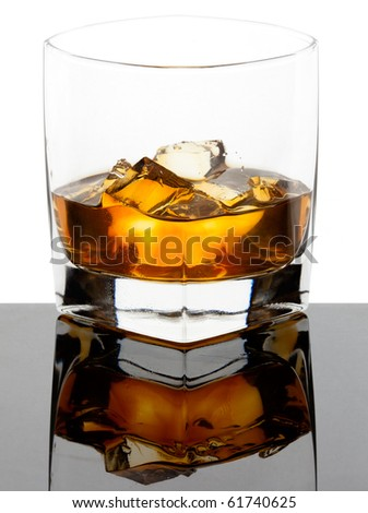Glass of whiskey with ice cubes on a black reflective glass and white background - stock photo