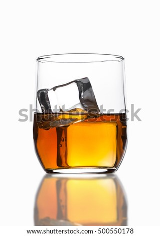 Glass of whiskey with ice cubes with reflection on white background