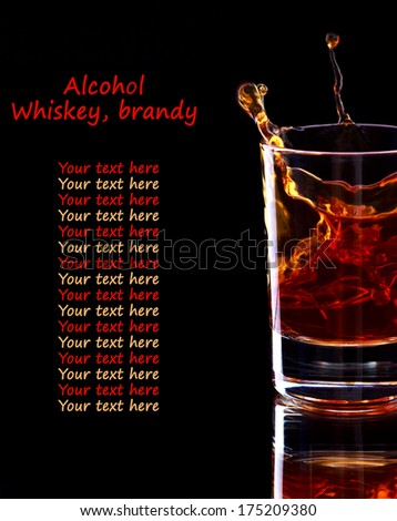 Glass of whiskey with splash on dark background with place for text, selective focus on the glass - stock photo