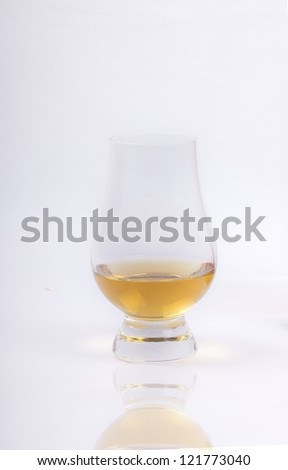 glass of whisky on a white background - stock photo