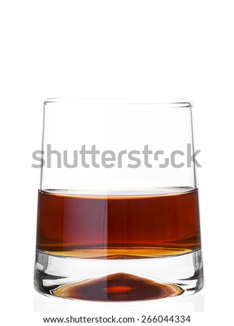 Glass of whisky on a white background of nobody, alcoholic drink of yellow color. - stock photo