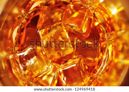 Glass of whisky with ice close-up view from above - stock photo