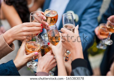 glass of white wine and champagne making toast - stock photo