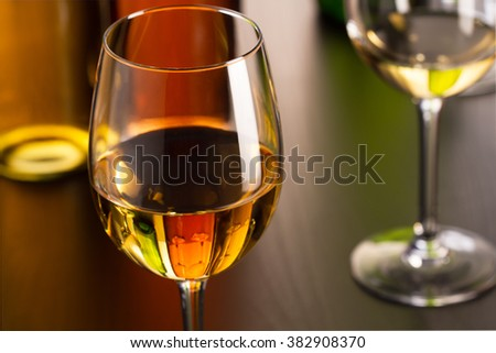 Glass of white wine on table - stock photo
