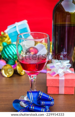 Glass of wine and colorful gifts in the festival