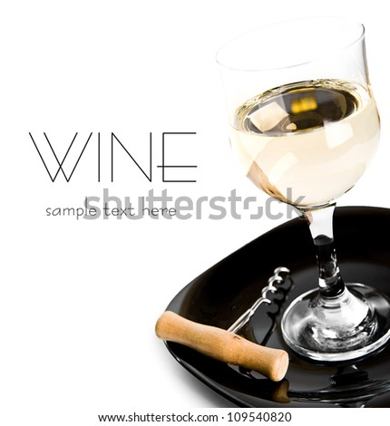 glass of wine and corkscrew over white - stock photo