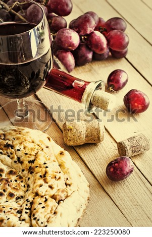 Glass of wine and grape on texture rusty wooden background - stock photo