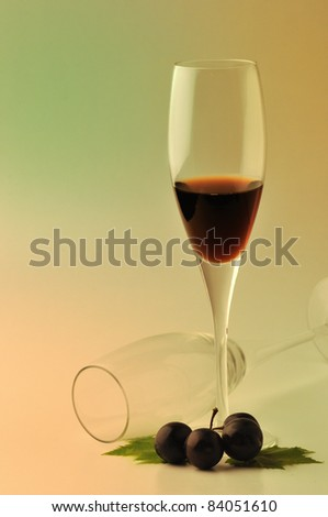 Glass of wine and grapes over white background - stock photo