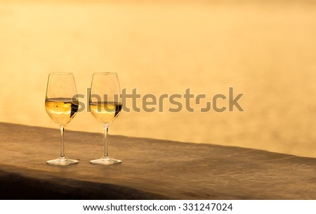 Glass of wine by the sea. - stock photo