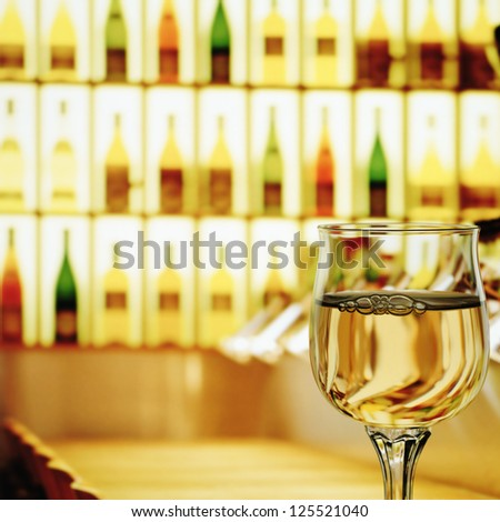Glass of wine in wine house - stock photo