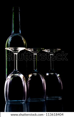 Glass of wine on a black background. - stock photo