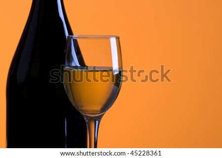 glass of wine on an orange background