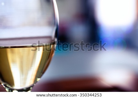 Glass of wine on blurred background