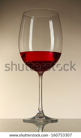 Glass of wine on gray background