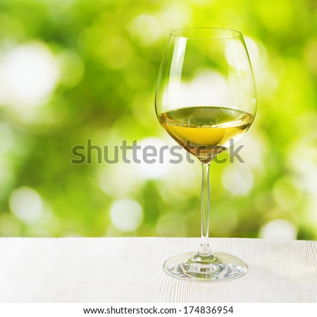 Glass of wine on nature background. - stock photo