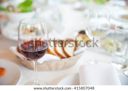 Glass of wine on served table