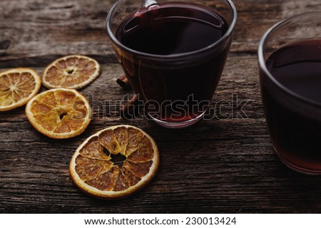 Glass of wine on the table - stock photo