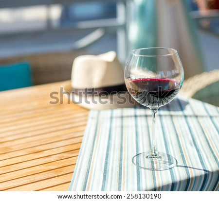 Glass of wine on the table in cafe - stock photo