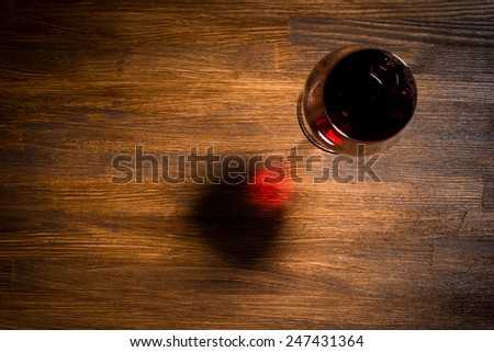 Glass of wine on wooden table. Top view - stock photo