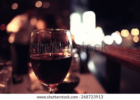 glass of wine restaurant interior serving dinner