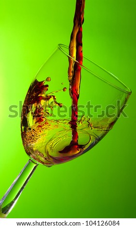 Glass of wine, splash of red wine - stock photo