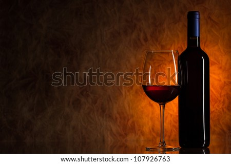 Glass of wine with bottle of wine